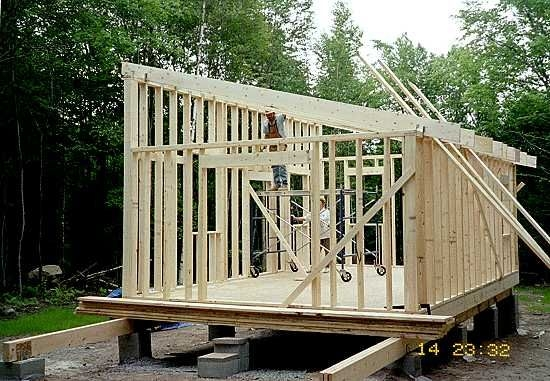 have you considered a 14x24 with a shed or low sloped roof Slant Roof Cabin With Loft