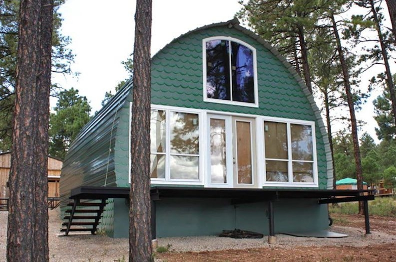 these prefab arched cabins provide cozy homes for under 10k Tiny Prefab Cabins