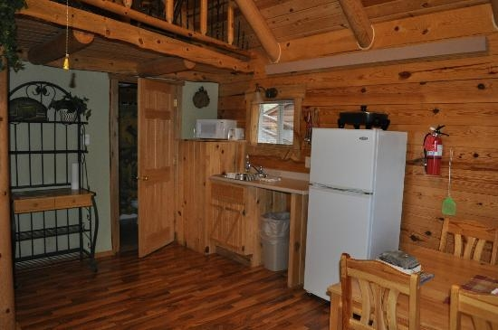 kitchen area of hunters haven and door to bathroom picture Rustic Ridge Guest Cabins