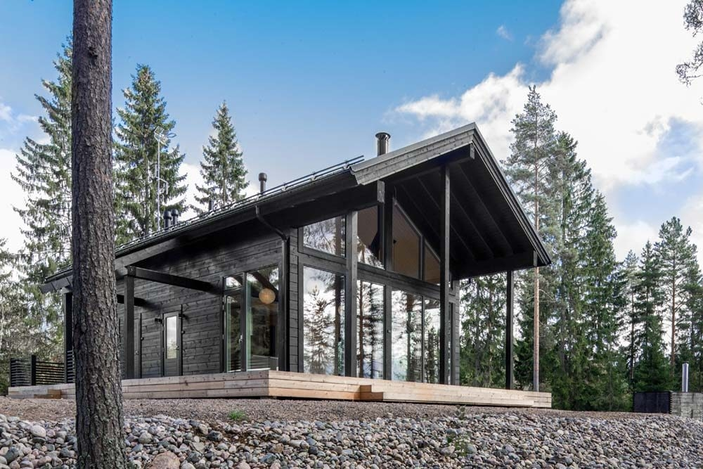 beautiful log cabin design in finland with floor to ceiling Small Modern Log Cabin