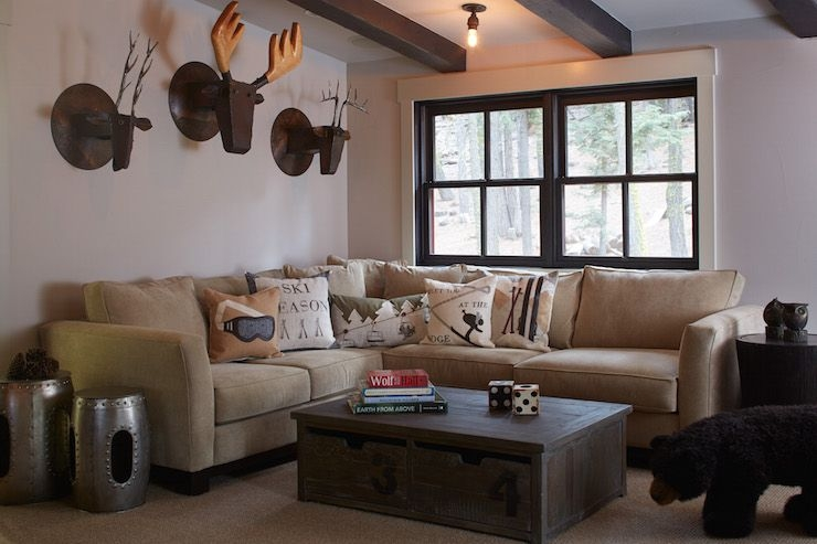 country cabin living room features ceiling dotted with dark Country Cabin Living Room Ideas