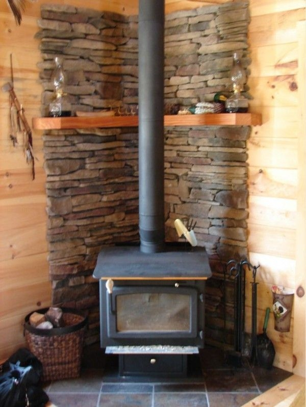 image of wonderful wood stove in small cabin with wicker log Small Wood Stoves For Cabins