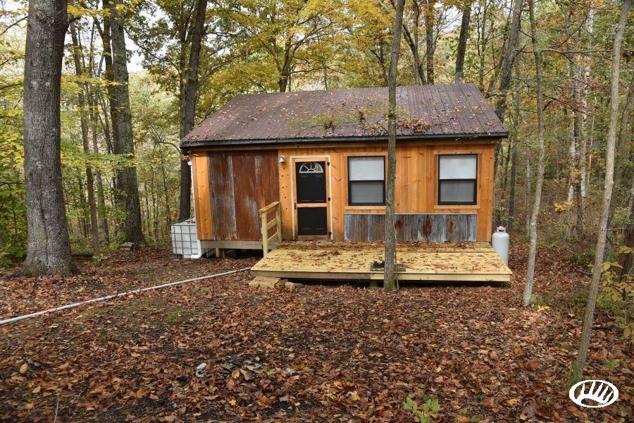 off grid cabin with solar power nestled in the shawnee Offgrid Cabin