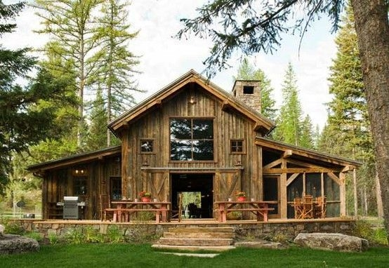 rustic cabin in swan valley made mainly of wood and stone Pole Barn Cabin Ideas
