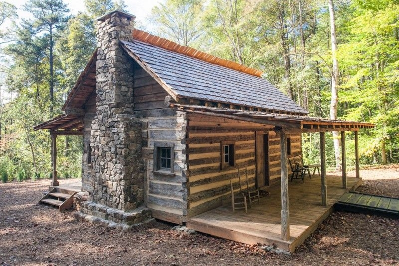 small rustic cabins trees chairs small windows wooden walls Rustic Cabins