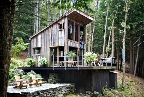 small hut in the forest enchanted with rustic furnishings Forest Cabin Designs