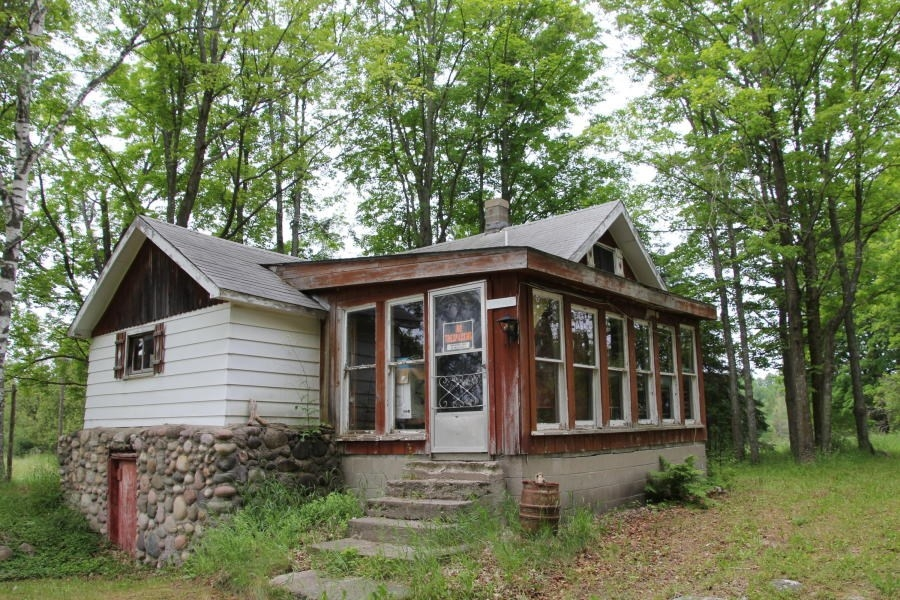 cabins on private lake for sale with 87 acres in onaway mi Lake Cabin For Sale Michigan