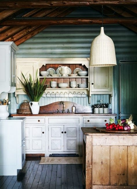 cozy log cabin kitchen with blue painted interior wood walls Cottage Cabin Kitchens