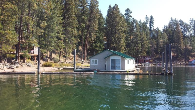 floating cabin with private beach and dock has terrace and Coeur D'Alene Lake Cabin Rentals