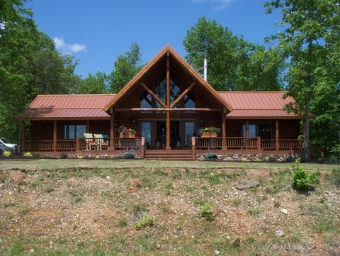 what makes a lodge real log homes Cabin Cottage Definition