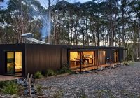 a modern prefab cabin in two parts connected with a deck Modern Prefab Cabin