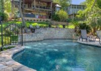 lake house with two story boat dock hot tub with a view Lake Cabin Austin Tx