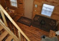 living room of hunters haven looking down from the loft Rustic Ridge Guest Cabins