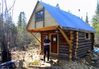 man builds tiny log cabin for 500 Tiny Log Cabin