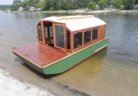 man designs micro houseboat you can build for cheap Tiny Cabin Boats